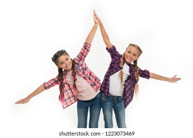 Dress to match your friend. Best friend dressing. Girls friends wear similar outfits have same hairstyle kanekalon braids white background. Sisters family look outfit. Dress similar with best friend.