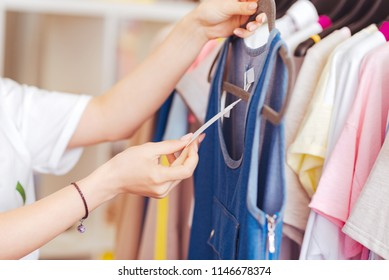 Dress price. Real shopaholic feeling extremely curious while looking at the price of summer denim dress