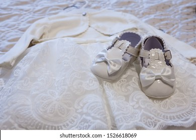 dress and shoes for a child's christening