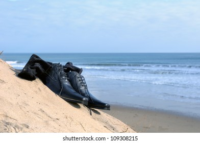 Dress shoes with sock on the beach