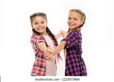 Dress similar with best friend. Dress to match your friend. Best friend dressing. Girls friends wear similar outfits have same hairstyle kanekalon braids white background. Sisters family look outfit.