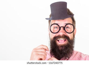Dress for success. Man bearded hipster hold cardboard top hat and eyeglasses to look smarter white background. Dress affects how people see you. Guaranteed ways appear smarter. Tricks to seem smarter.