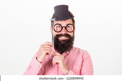 Dress for success. Man bearded hipster hold cardboard top hat and eyeglasses to look smarter white background. Guaranteed ways appear smarter. Tricks to seem smarter. Dress affects how people see you.