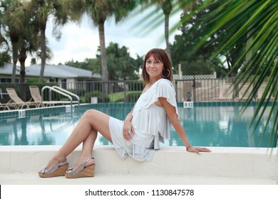 Dressed up young woman at outdoor by pool