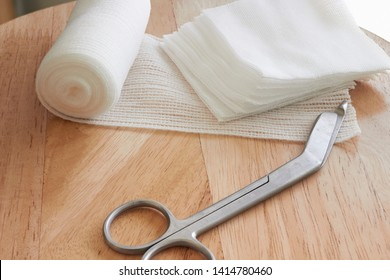 Dressing or clean wound tools includes Roll gauze,pile of gauzes and gauze roll cutter or scissors with sun flare
