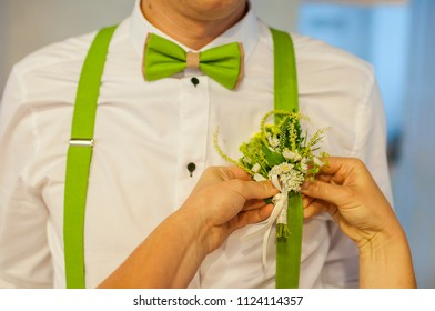 Dressing groom. taking shoes, closing the cuffs,