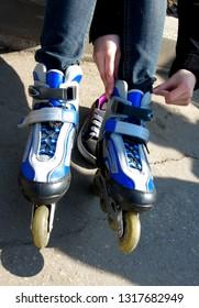 Dressing roller skates.
