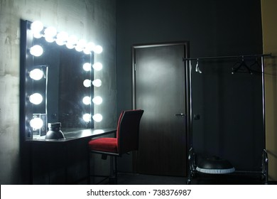 Dressing room with chair, table, mirror and light in the photo studio