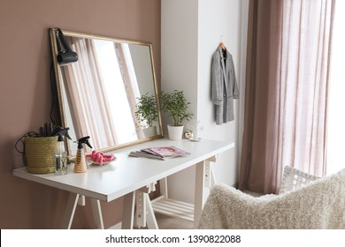 Dressing table with big mirror in room