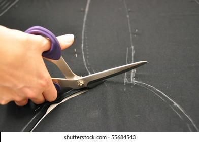 Dressmaker cutting fabric