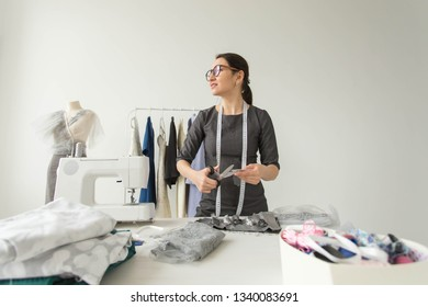 Dressmaker, fashion designer, tailor and people concept - Portrait of a woman seamstress at work
