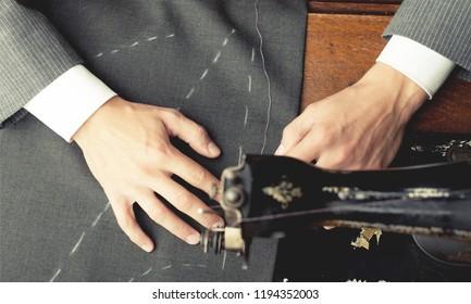 Dressmaker measuring tailor pattern