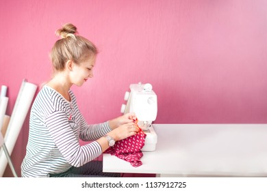 Dressmaker woman working with sewing machine. Fashion Design Sewing Machine Concept. copy space