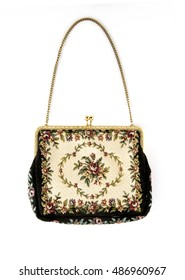 Dressy antique clutch with gold trim and chain, floral pattern in red, green, white, and black evening bag.