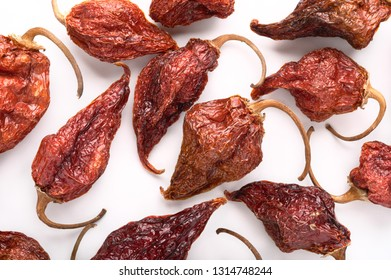 Dried Aji Limo Rojo chili peppers on a white background