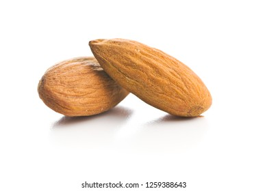 Dried almond nuts isolated on white background.