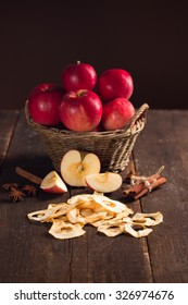 dried apples with beautiful red apples in the background