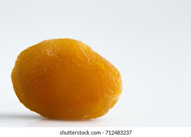 dried apricots heap against white background close up