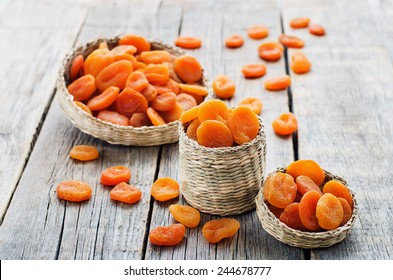 dried apricots on a dark wood background. tinting. selective focus