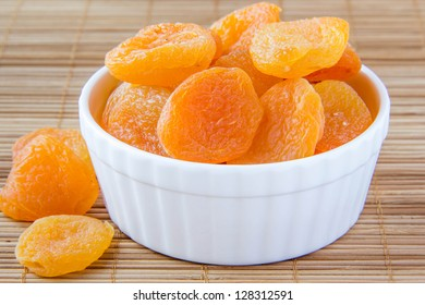 Dried apricots in a white ceramic bowl