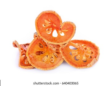 Dried bael fruits on a white background