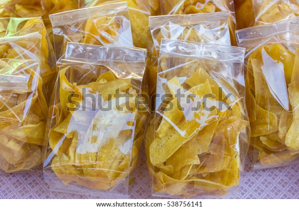 Dried banana dessert in plastic bags ,ready for sale.
