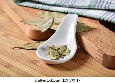 Dried bay leaves broken up into a spoon
