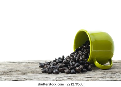 Dried beans falling from a coffee cup