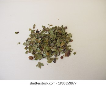 Dried bearberry leaves and fruits, arctostaphylos uva-ursi, on a wooden board