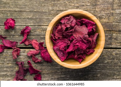 Dried beetroot chips in bowl.