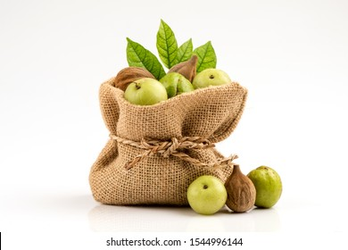 Dried Beleric Myrobalan,Chebulic Myrobalans and Indian gooseberry ,fruits on a white background or Triphala is an herbal remedy that is a combination of Beleric Myrobalan, Chebulic Myrobalans and Indi