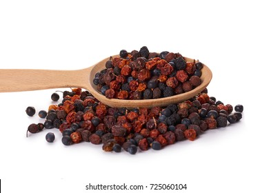 dried berries in wooden spoon isolated on white background