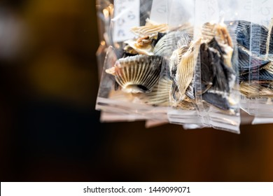 Dried blowfish or Japanese tiger puffer fins for hirezake hot sake drink in plastic bags packages in Tsukiji fish street outer market in Ginza, Tokyo Japan