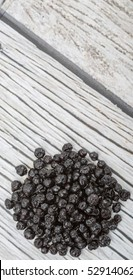 Dried blueberry over wooden background