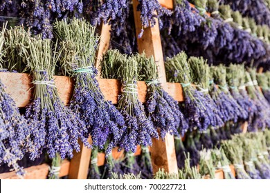 Dried bunches of lavender hanging on wooden ladders. Traditional lavender flower drying