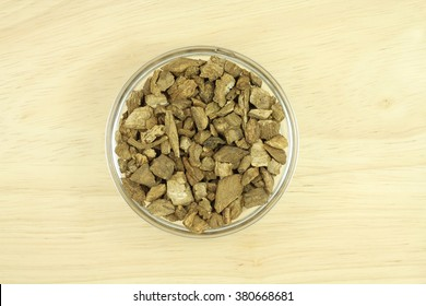 dried burdock root in a glass texture