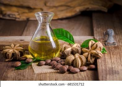 dried capsule seeds fruit of sacha-Inchi peanut on wooden table.  (Plukenetia volubilis)