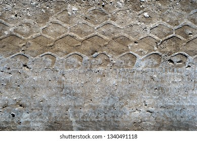 Dried car vehicle tire tracks on a dirty dusty road in horizontal design with copyspace area for transport adventure based ideas and themes