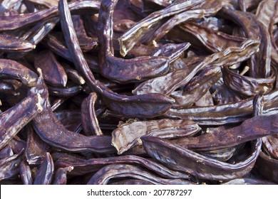 Dried carob cloves close up