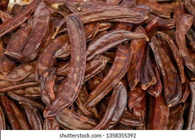 Dried Carob Pods clouse-up. Locust Bean isolated. Locust Bean background. Healthy food. Dried vegetarian food