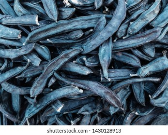 Dried carob pods on the market. Locust beans is used to replace cocoa powder.
