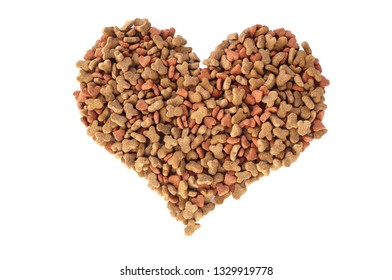 Dried cat food biscuits in a heart shape, isolated on a white background