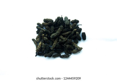 Dried catkins or fruits of long pepper(Piper longum),  sometimes called Indian long pepper (pipli) or Thippali isolated on white