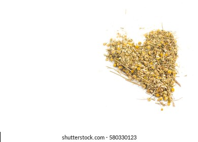 Dried chamomile heart shaped isolated on white background