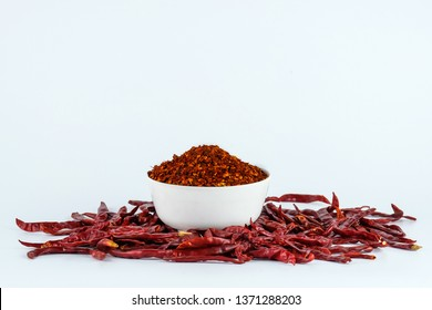 dried chili flakes isolated on white background,  Cooking spices, spice Red chilli powder heap