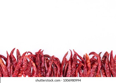 Dried chili isolated on white background Arrange in a beautiful line.