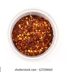 dried chilli flakes isolated on white background