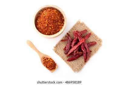 dried chilli and powder chilli on white background