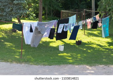 Dried clothes in the yard on ropes