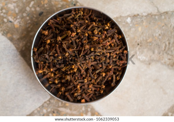 Dried cloves in bowl